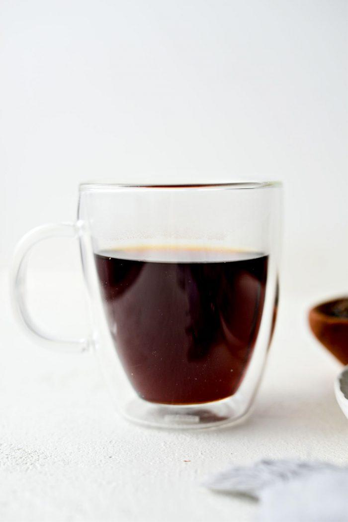 pour tea into large mug