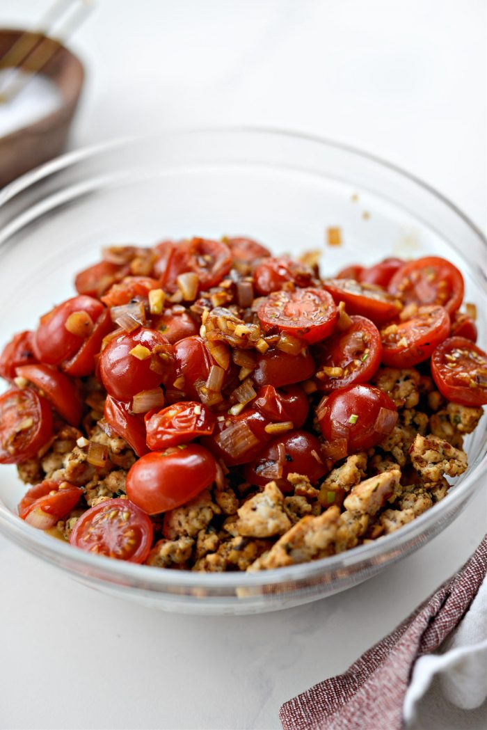 transfer tomato mixture to bowl with sausage.
