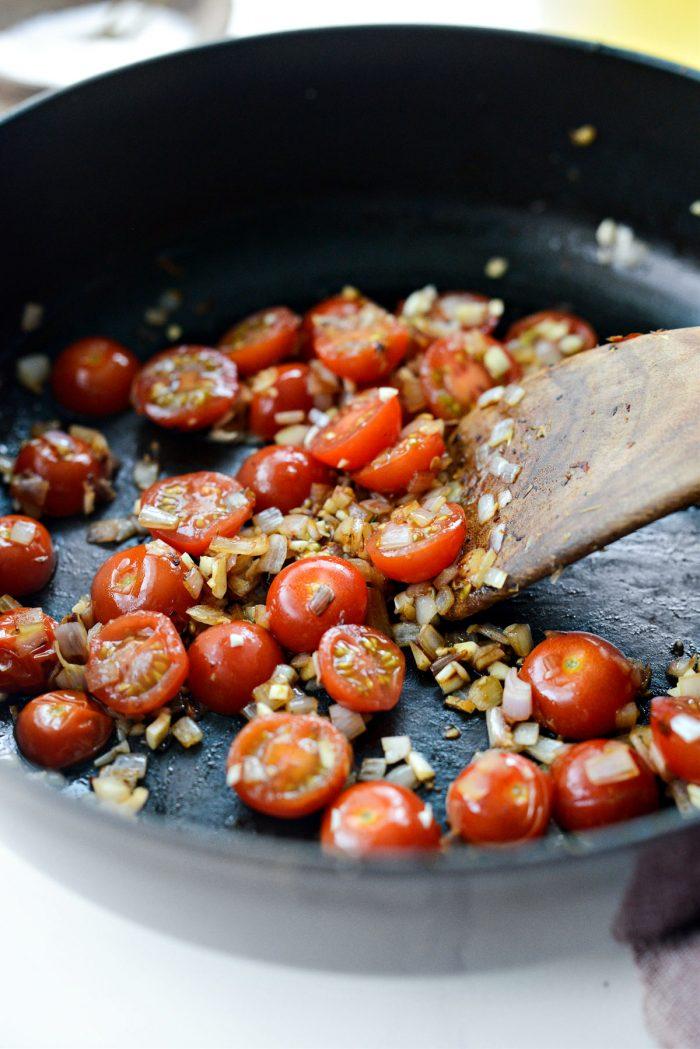 sauteed tomatoes, shallots and garlic in skillet.