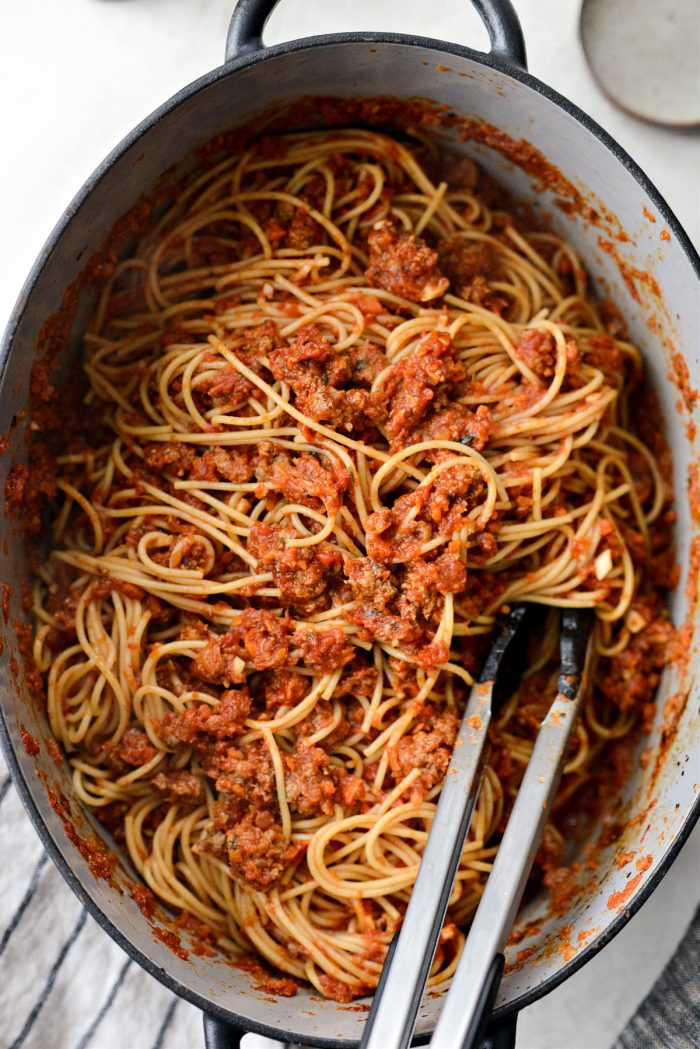 toss cooked pasta in sauce
