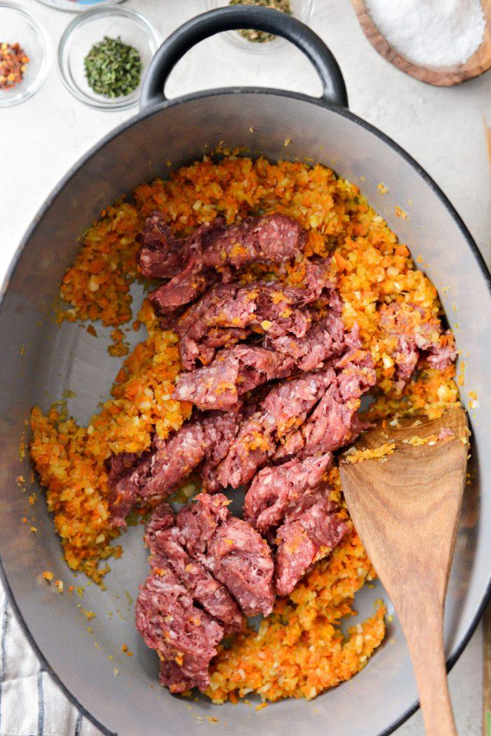 add lean ground beef to veggies and garlic