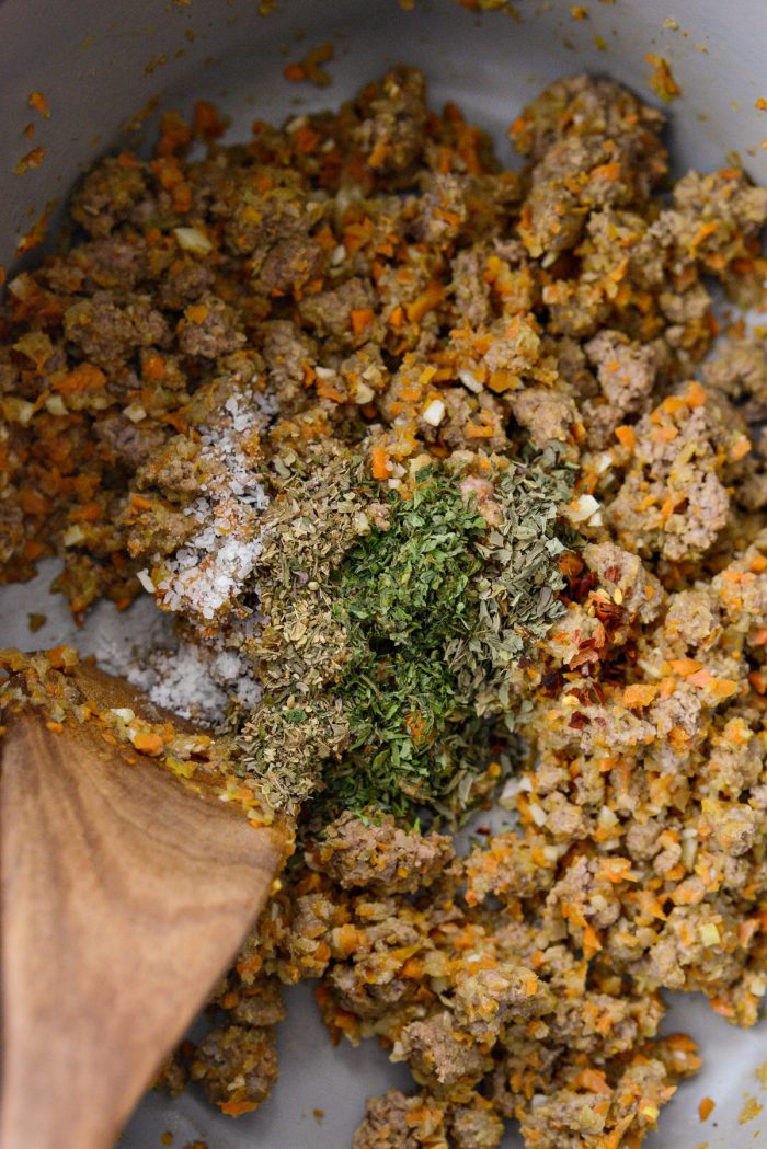 dried herbs and spices added to cooked meat mixture