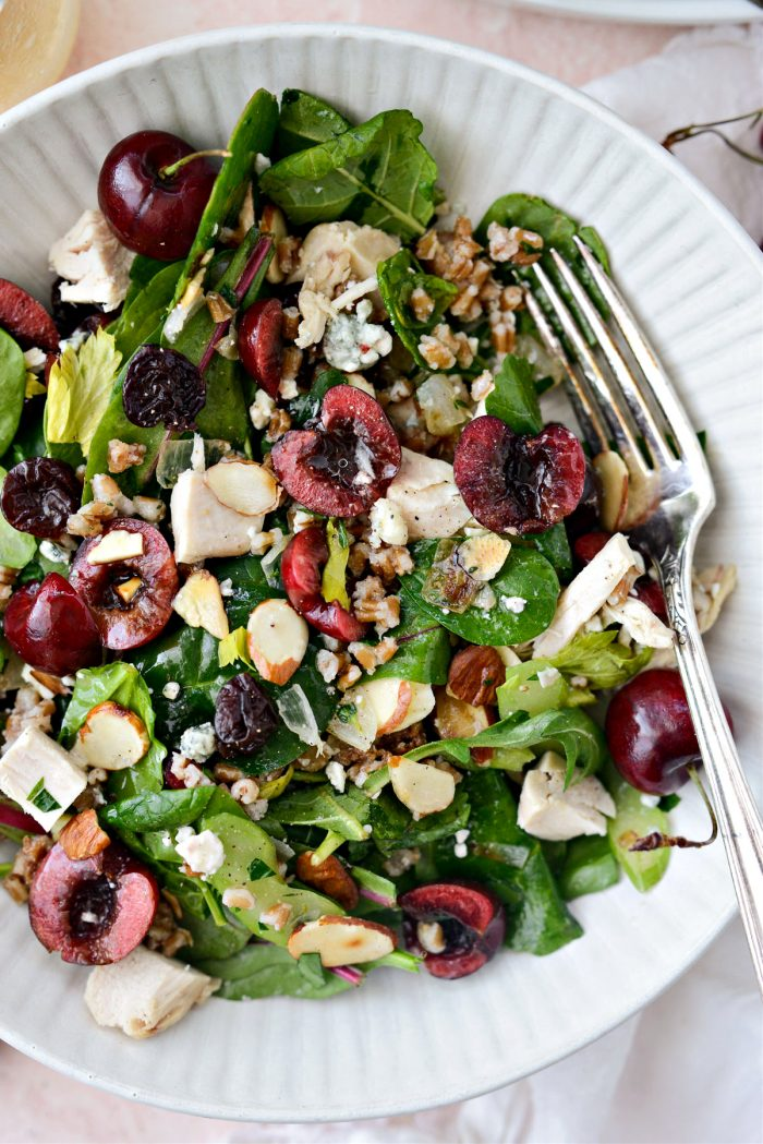 Cherry Winter Wheat Berry Salad in cream bowl with silver fork