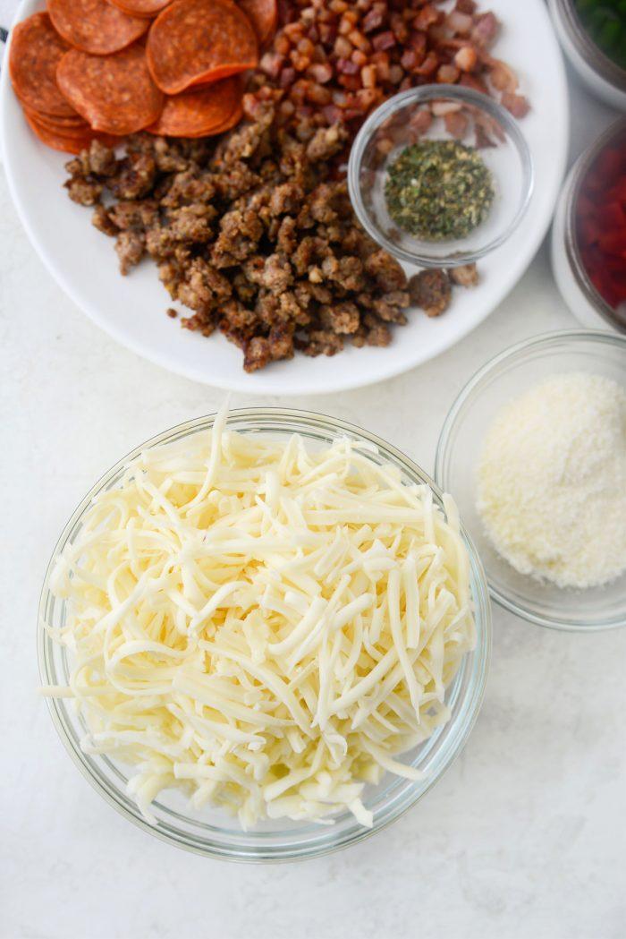 bowls of fontina, mozzarella and parmesan