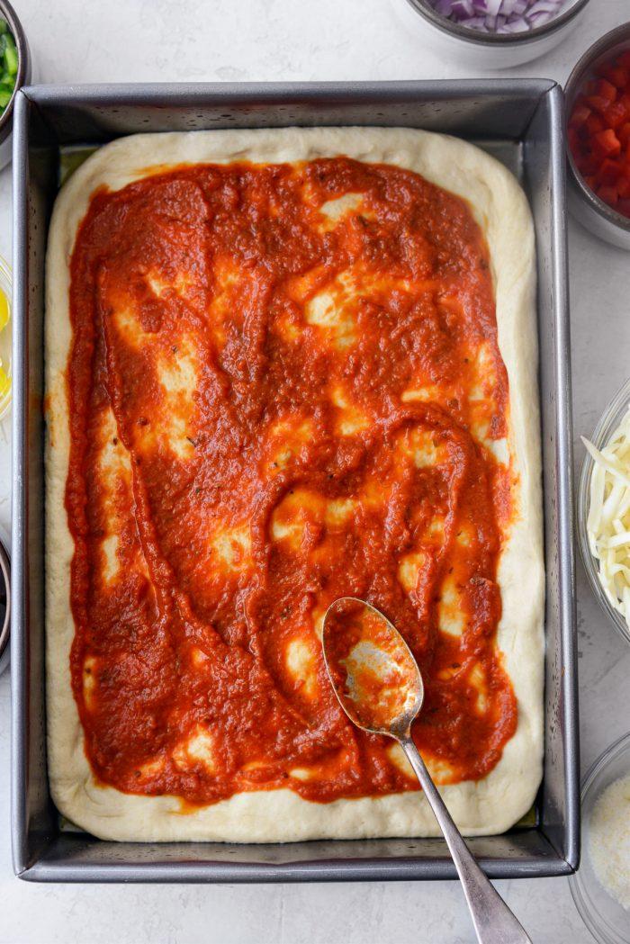 spread pizza sauce