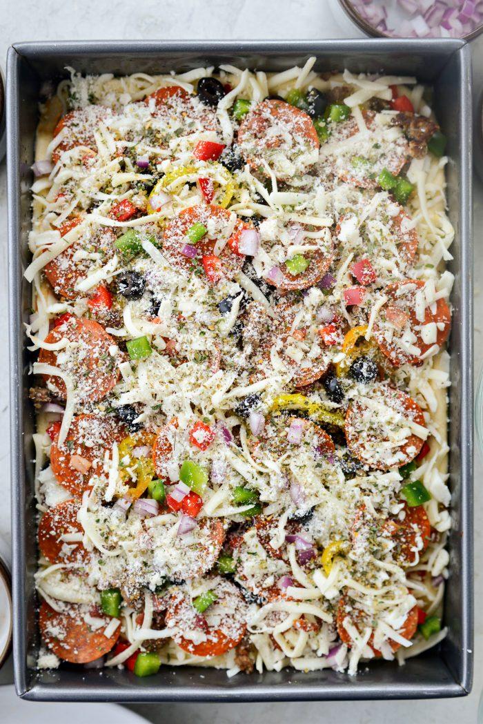 remaining mozzarella, fontina and top with parmesan and italian seasoning
