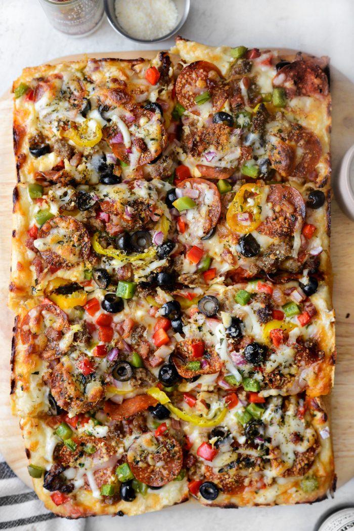 Focaccia Pizza Supreme sliced into eight pieces