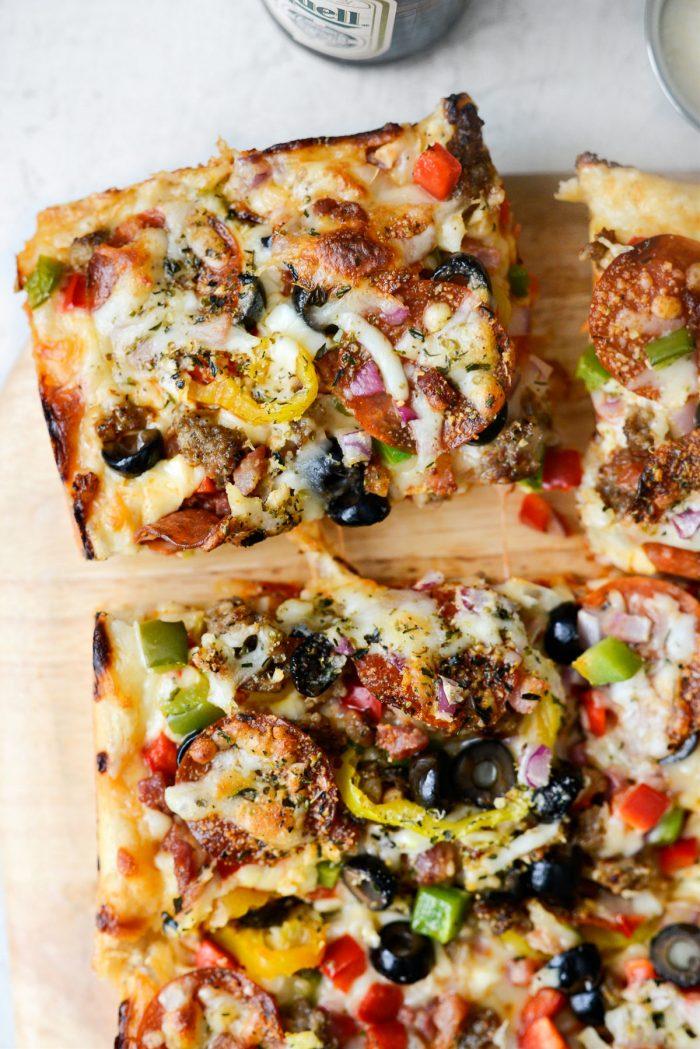 Corner piece of Focaccia Pizza Supreme.