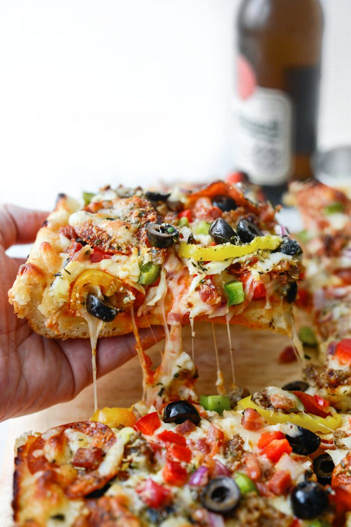 slice of Focaccia Pizza Supreme with cheese pulls
