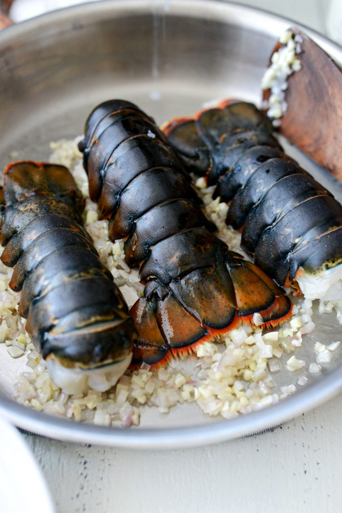 add lobsters to sauteed garlic and shallot.