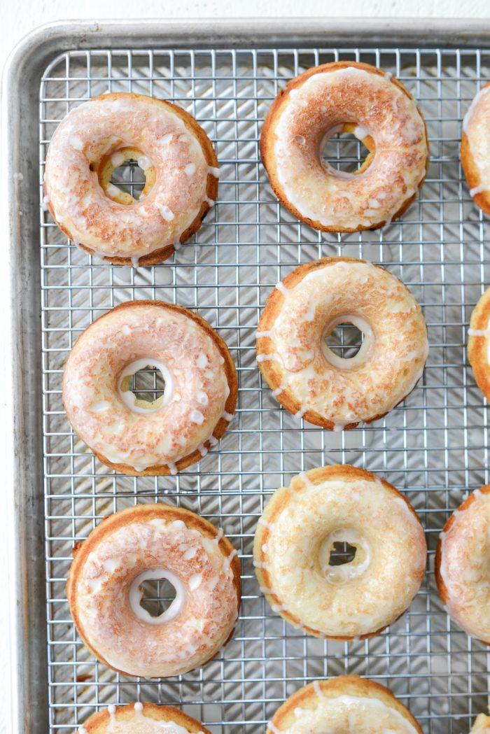 Glazed Buttermilk Cake Doughnuts on wire rack.