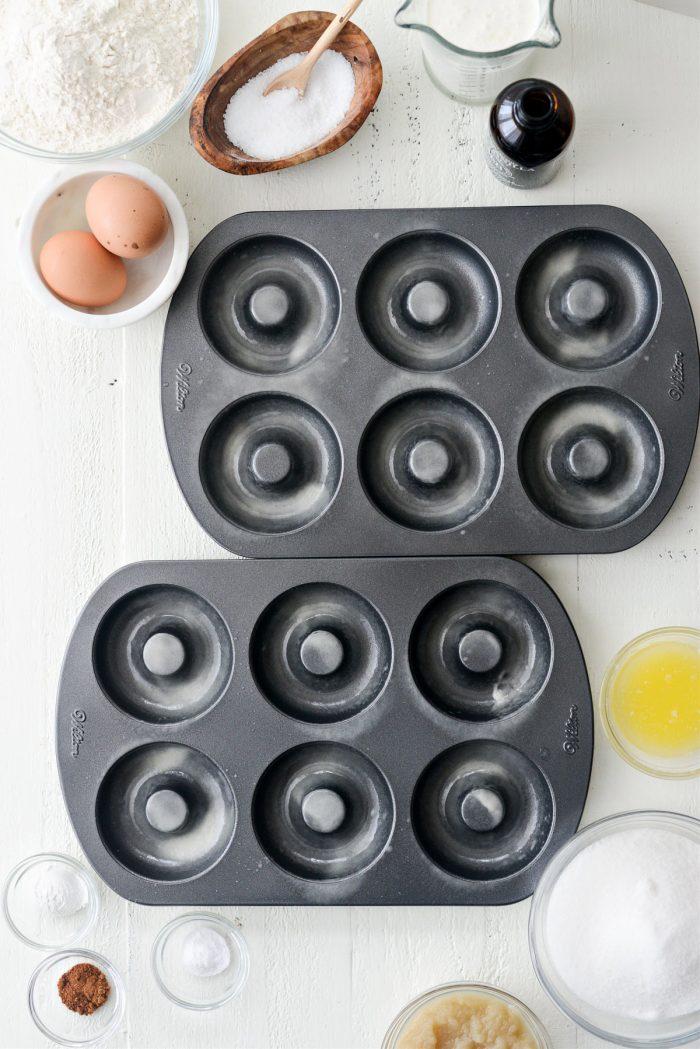 spray doughnut pans with nonstick spray