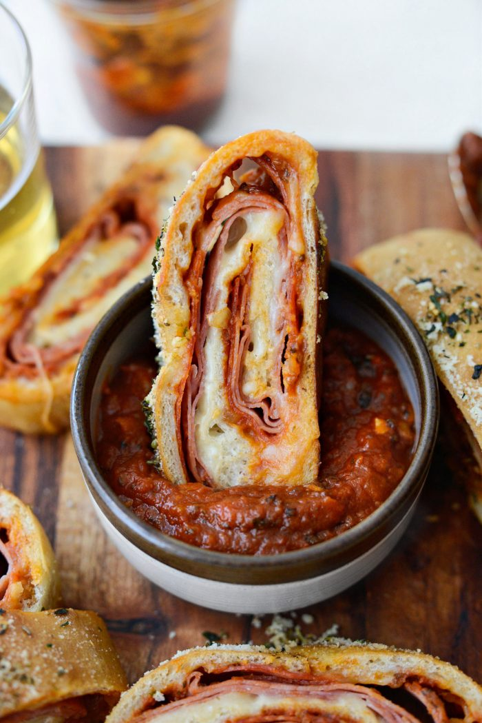 Homemade Stromboli dipped in extra pizza sauce