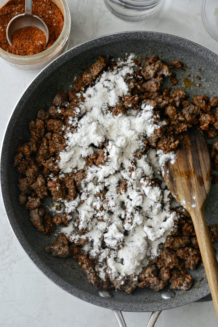 flour sprinkled over seasoned taco meat