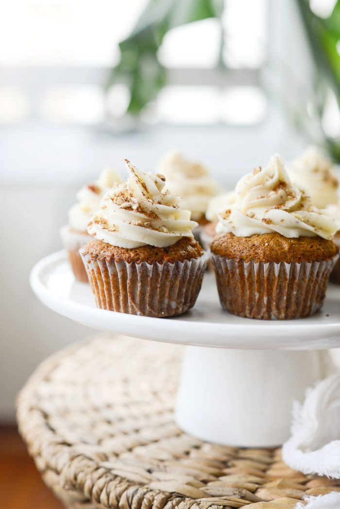 Carrot Cake Cupcakes on a white cake stand
