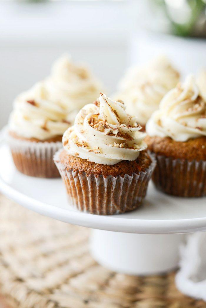 Carrot Cake Cupcakes on white pedestal platter.