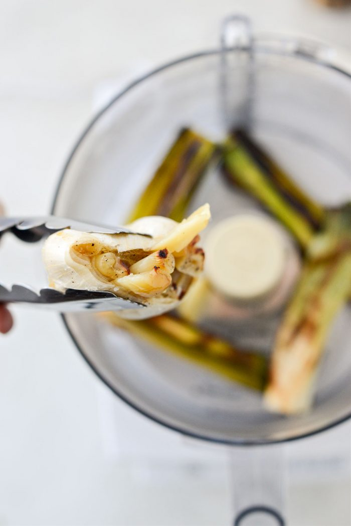 squeeze garlic into food processor with roasted leeks.