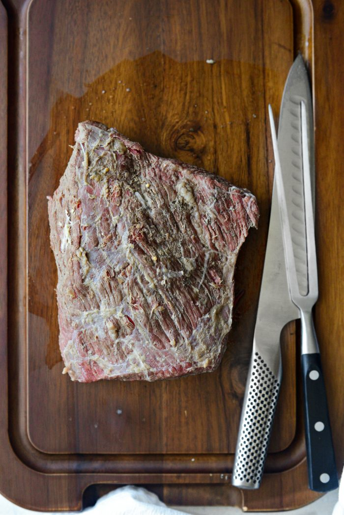 cooked corned beef on carving board
