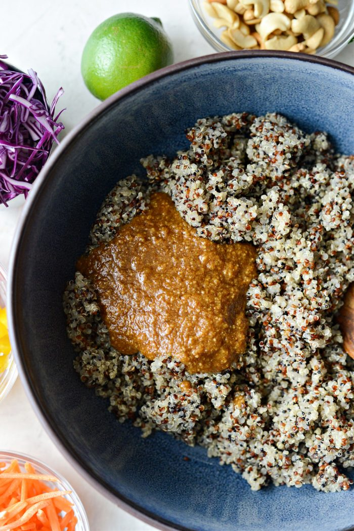 quinoa and dressing in serving bowl