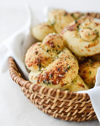 basket of Easy Homemade Garlic Herb Knots