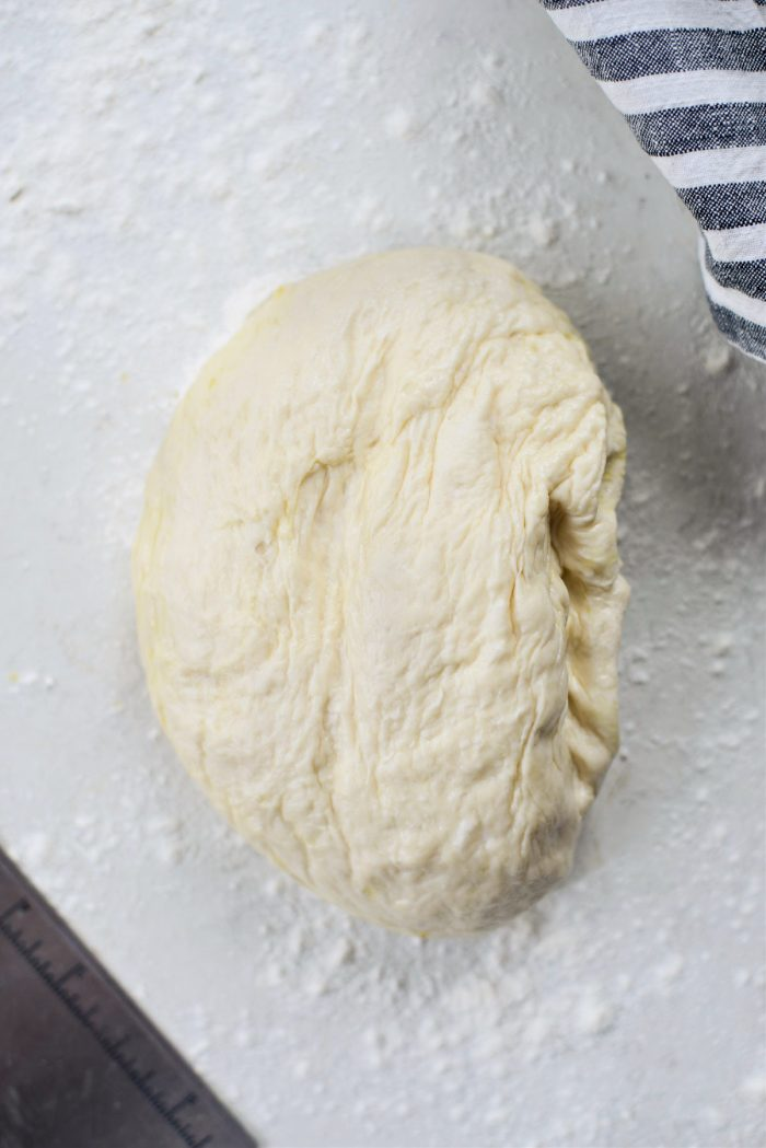 turn pizza dough out onto a floured surface