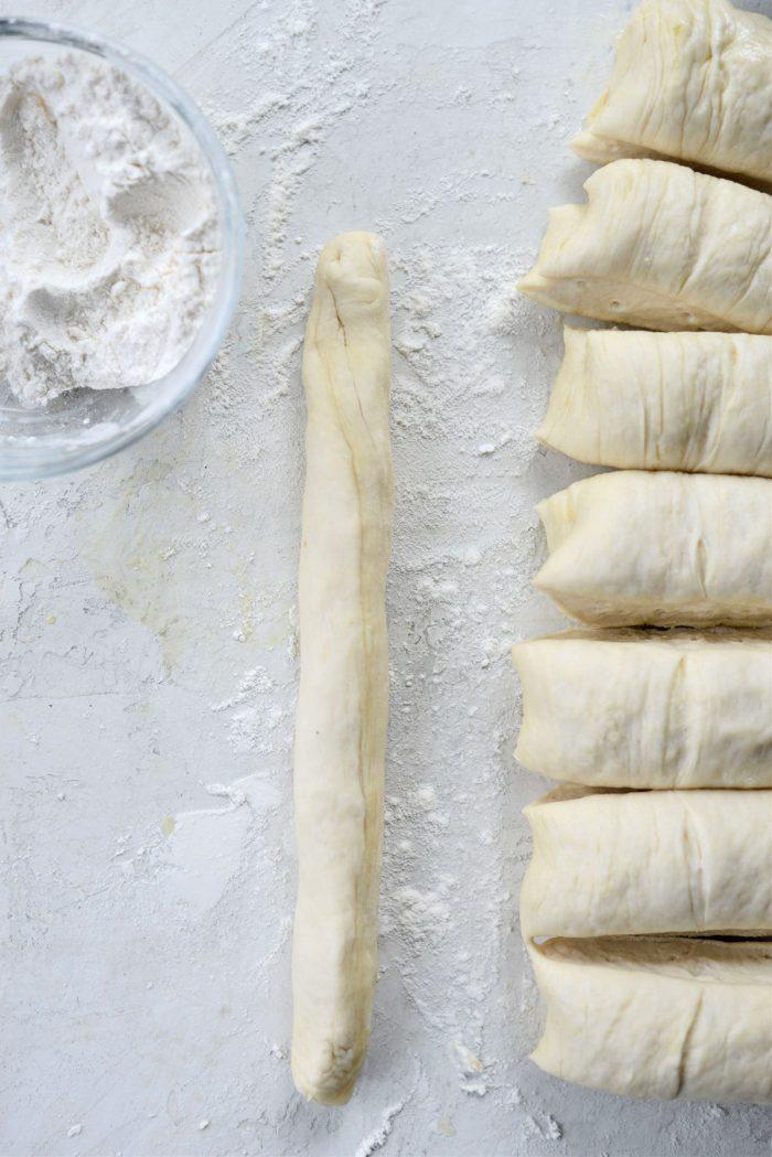 roll each piece into a log