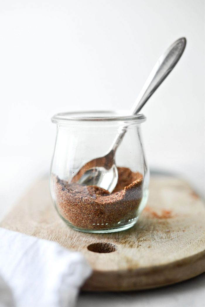 spoon in jar of Homemade Baja Seasoning Blend