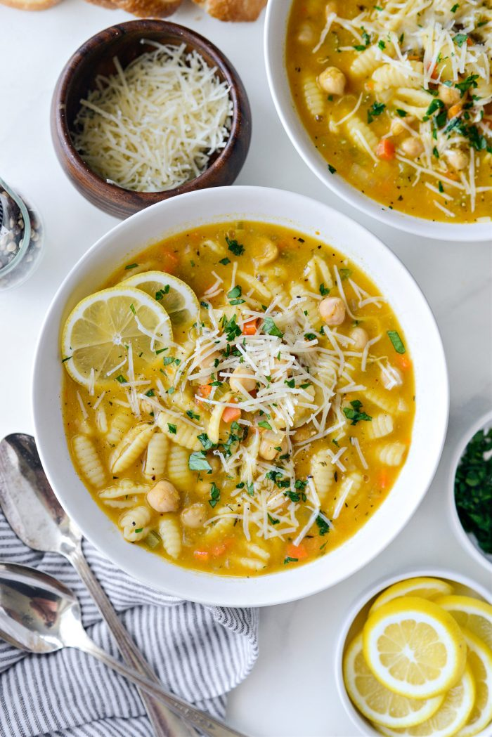 Lemon Chickpea Soup topped with parmesan and parsley.