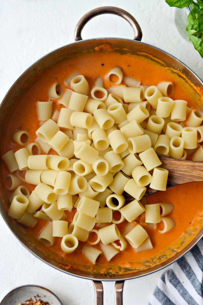 add cooked pasta to sauce