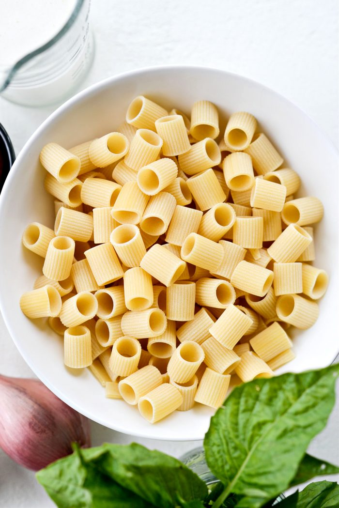 dried pasta in white bowl