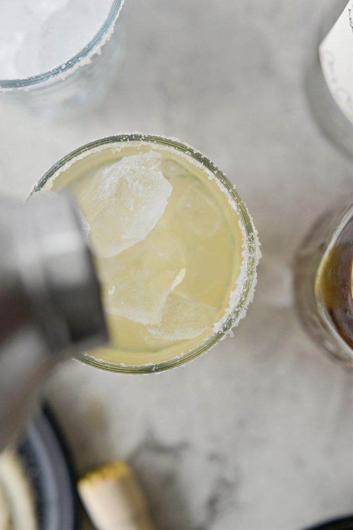 pour margarita into glasses
