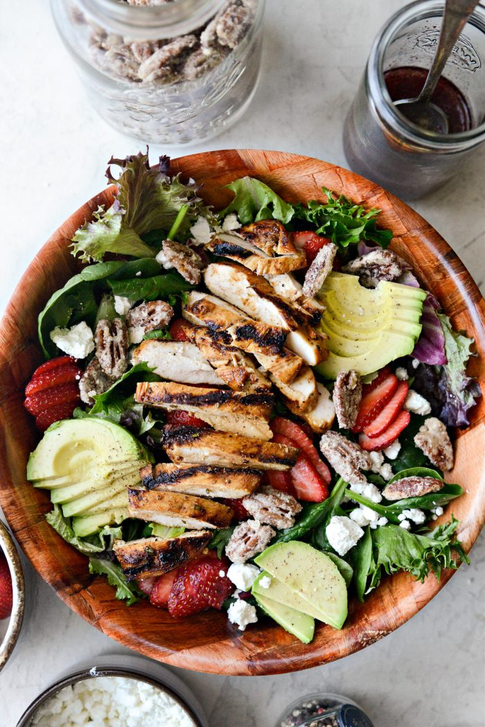 top with grilled chicken and candied pecans