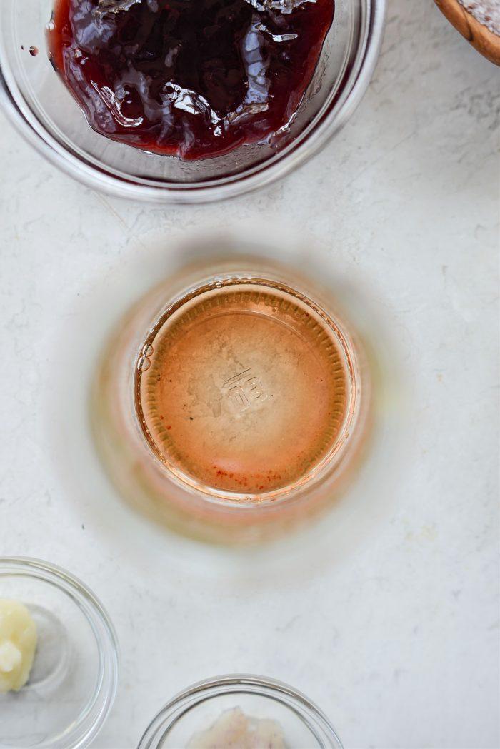 dissolve salt in vinegar