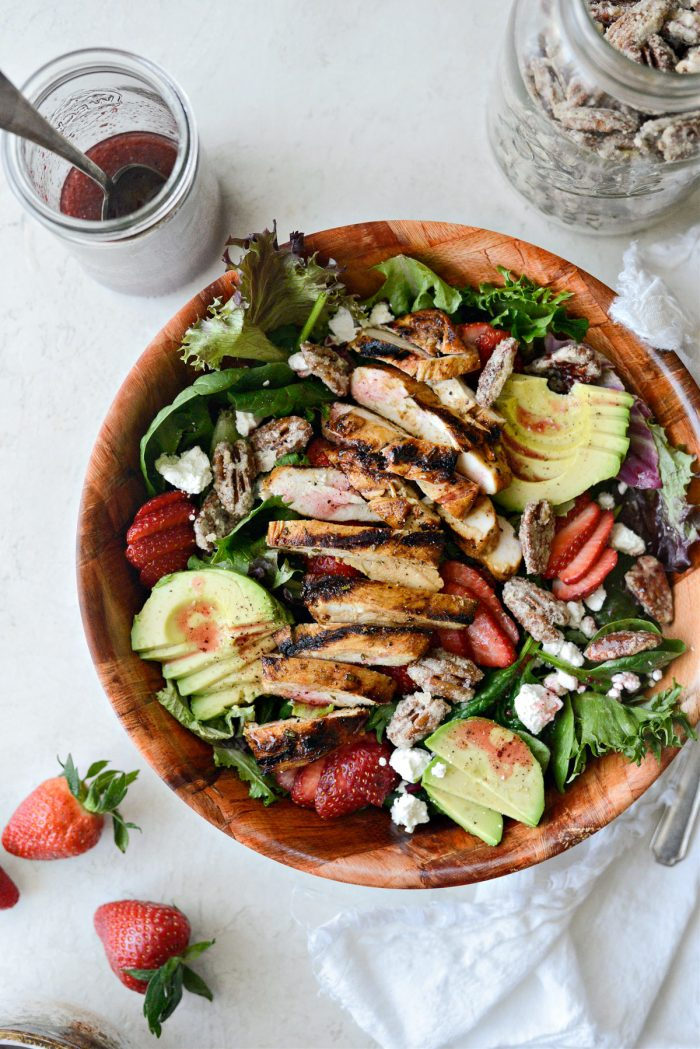 Strawberry Goat Cheese Spring Salad in wooden bowl