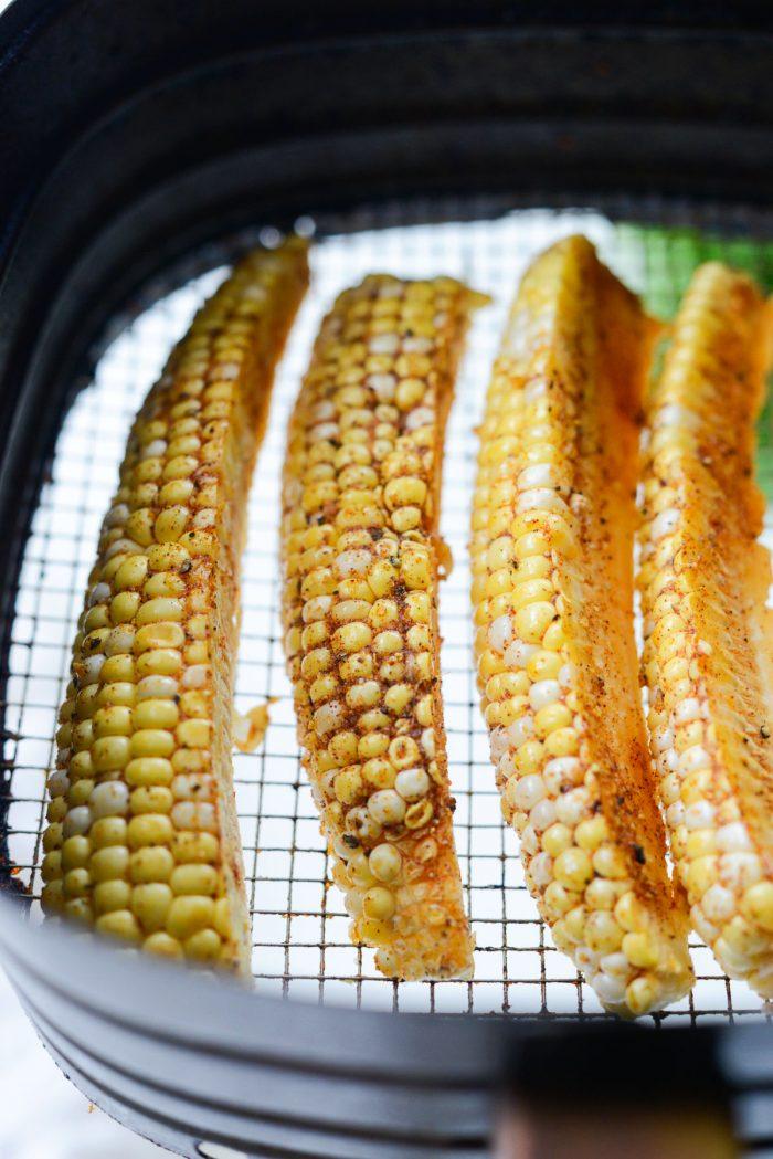 seasoned corn wedges in air fryer basket