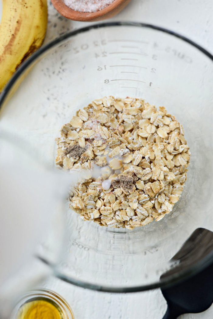 oats, spices and milk in a bowl