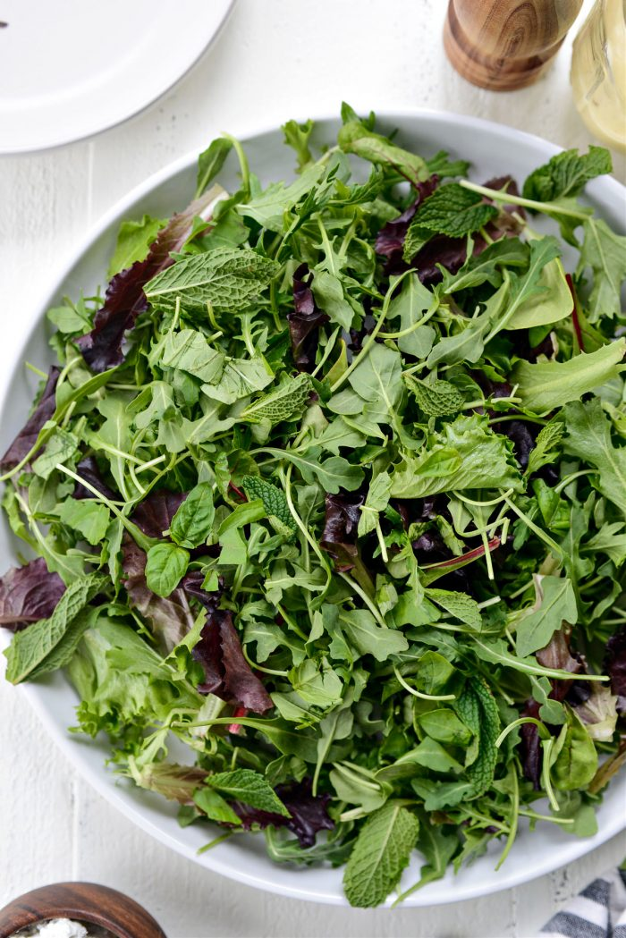 arugula, spring greens, mint and basil on platter