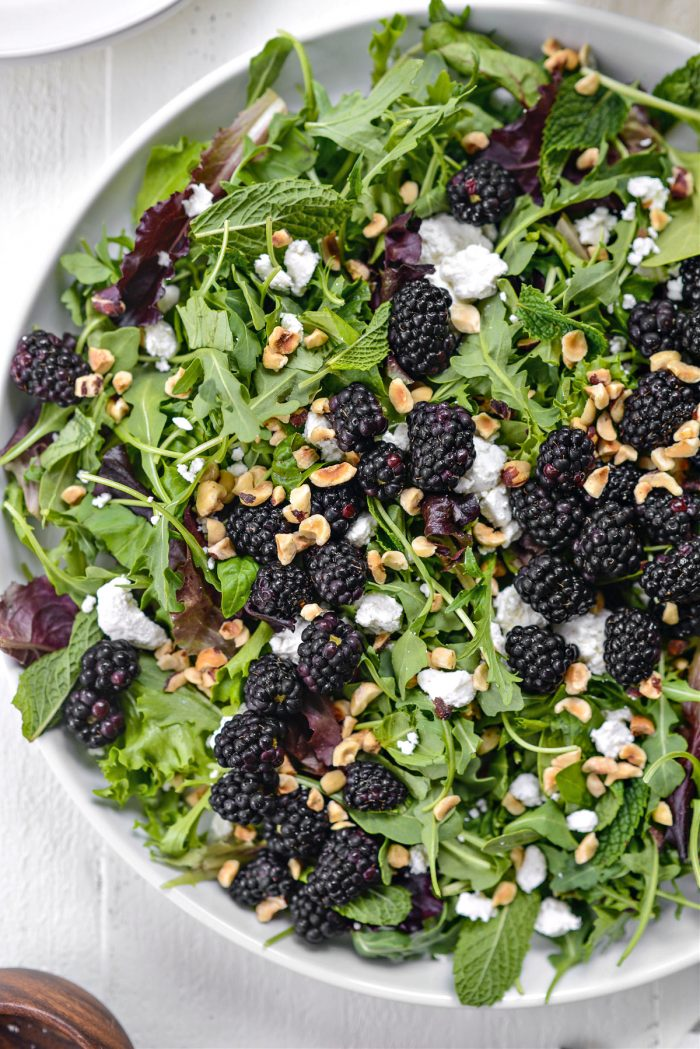 greens topped with blackberries, toasted hazelnuts and goat cheese