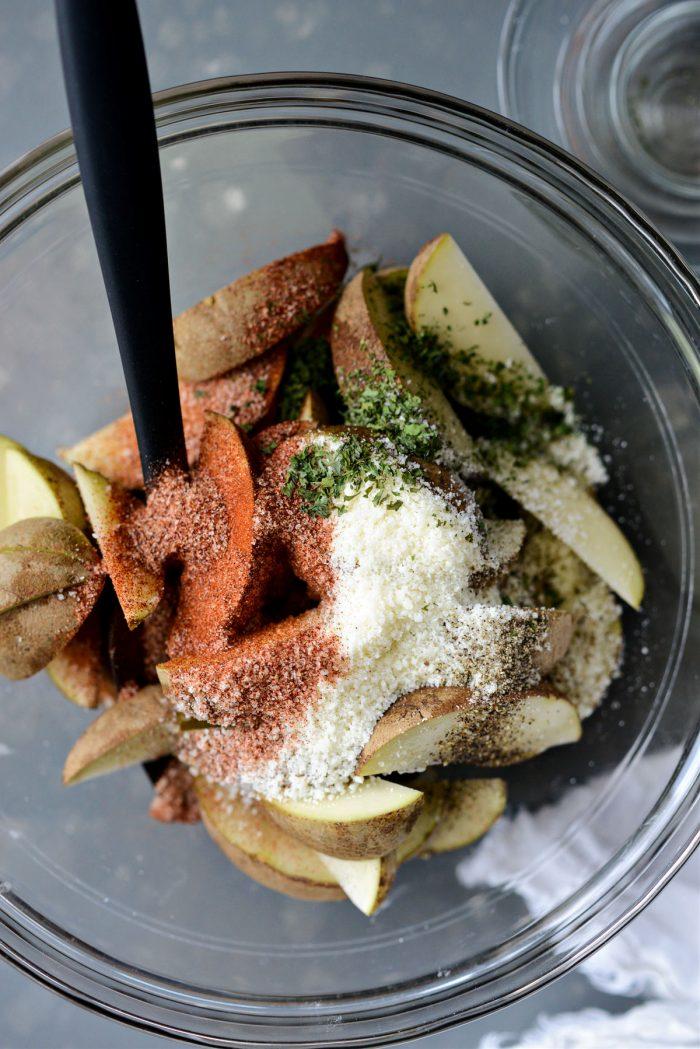 all-purpose seasoning, pecorino, parsley and pepper added to potatoes