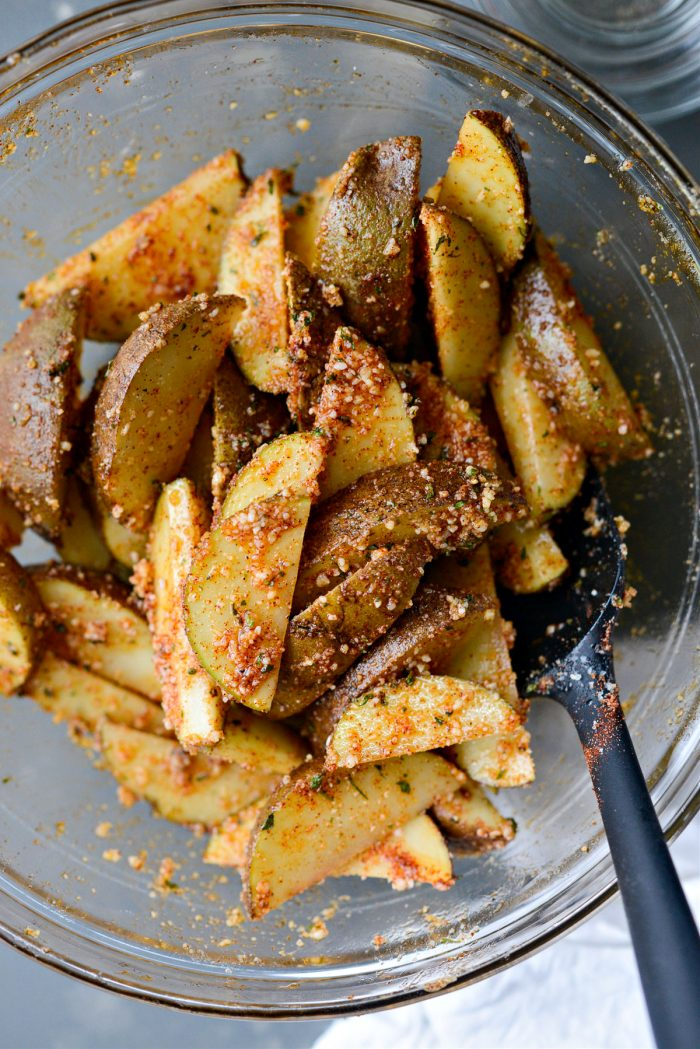 potatoes tossed in oil, herbs and spices