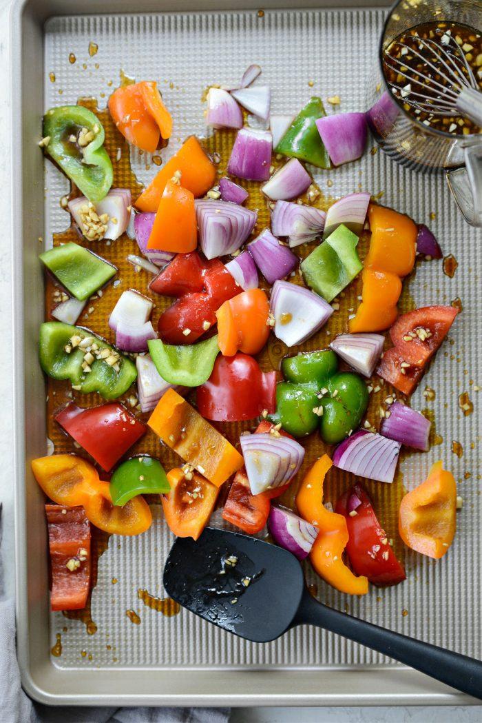 tossing veggies in sauce