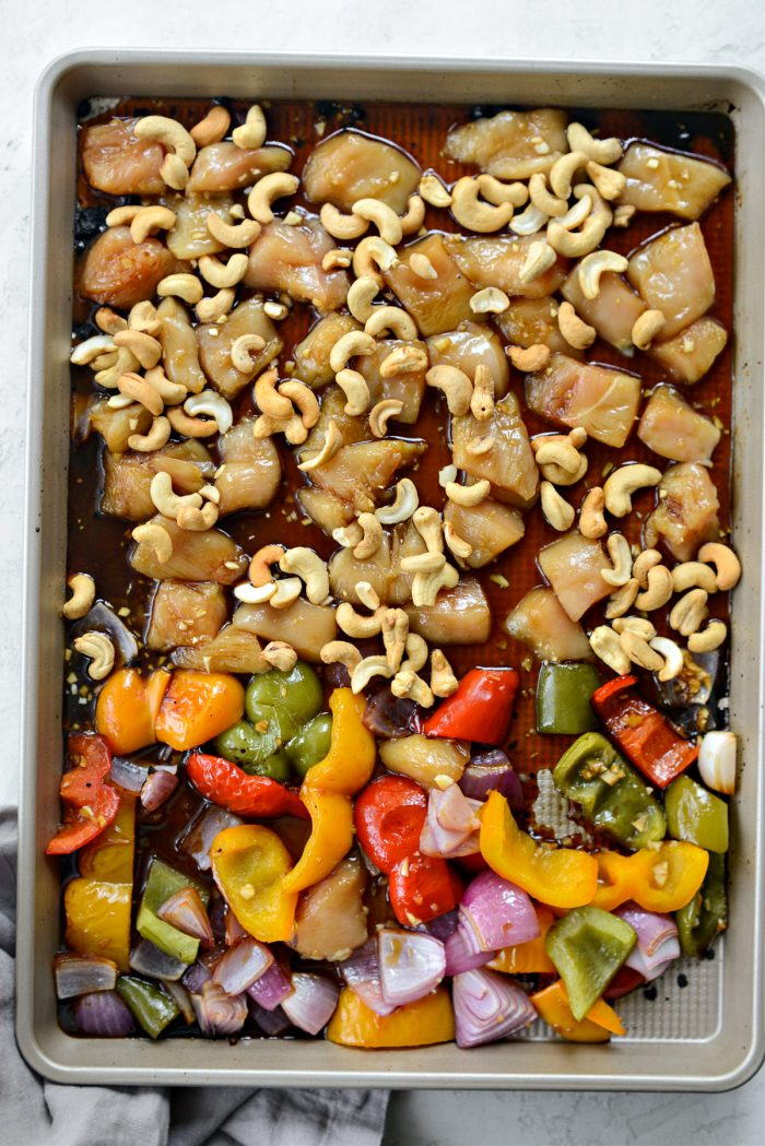 scoot veggies to side and add chicken and cashews