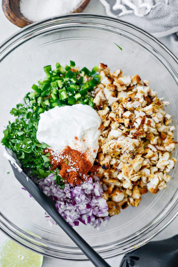greek yogurt and chili powder in bowl.