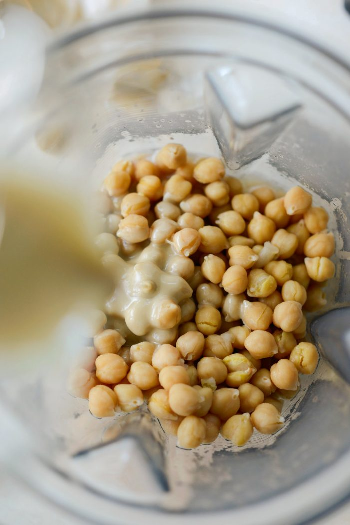 add chickpeas to blender and add tahini