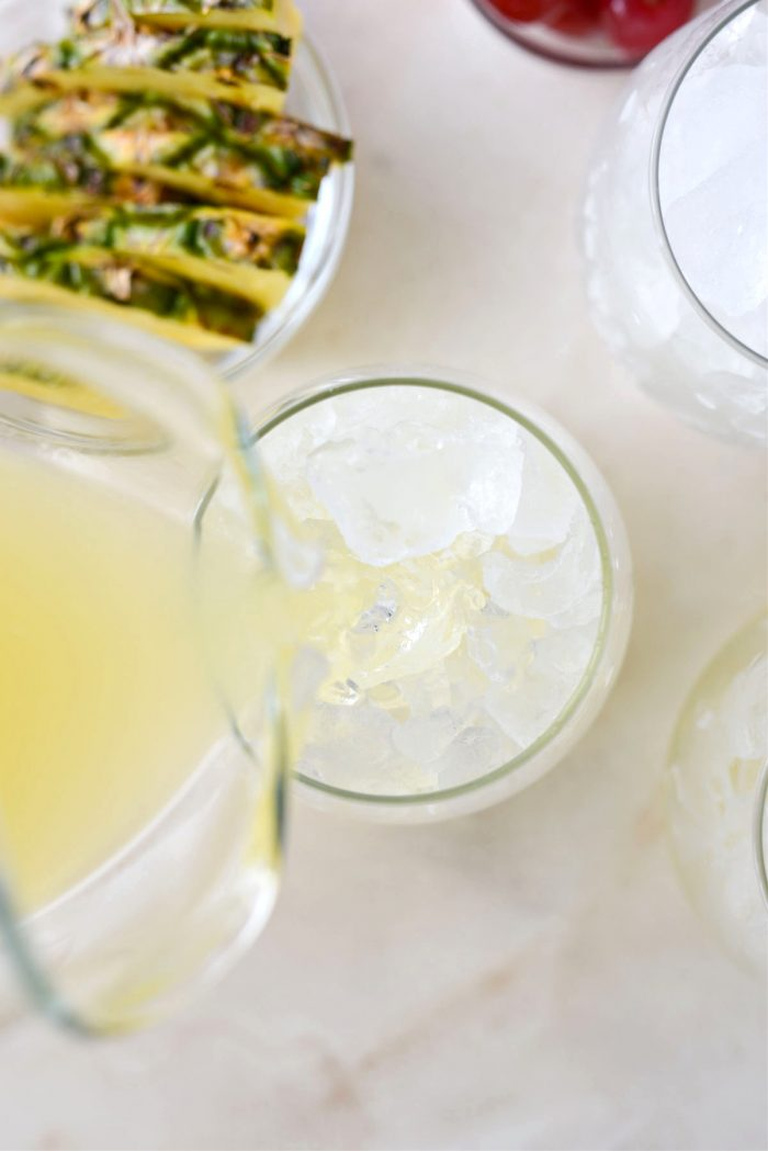 pour pineapple tequila mixture