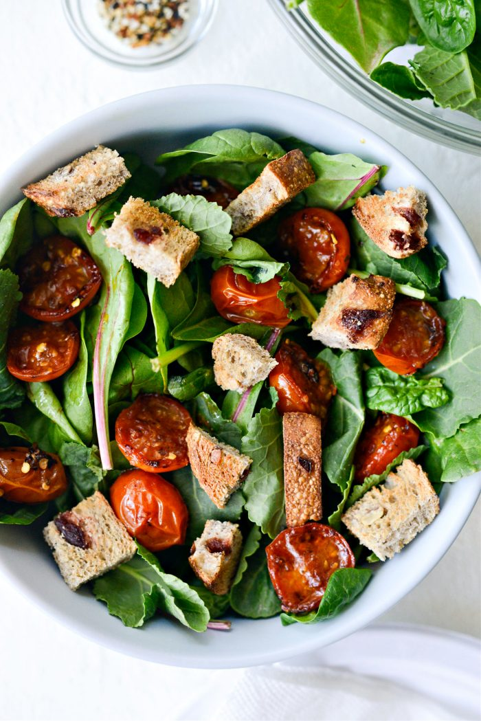 power greens, seared tomatoes and toast
