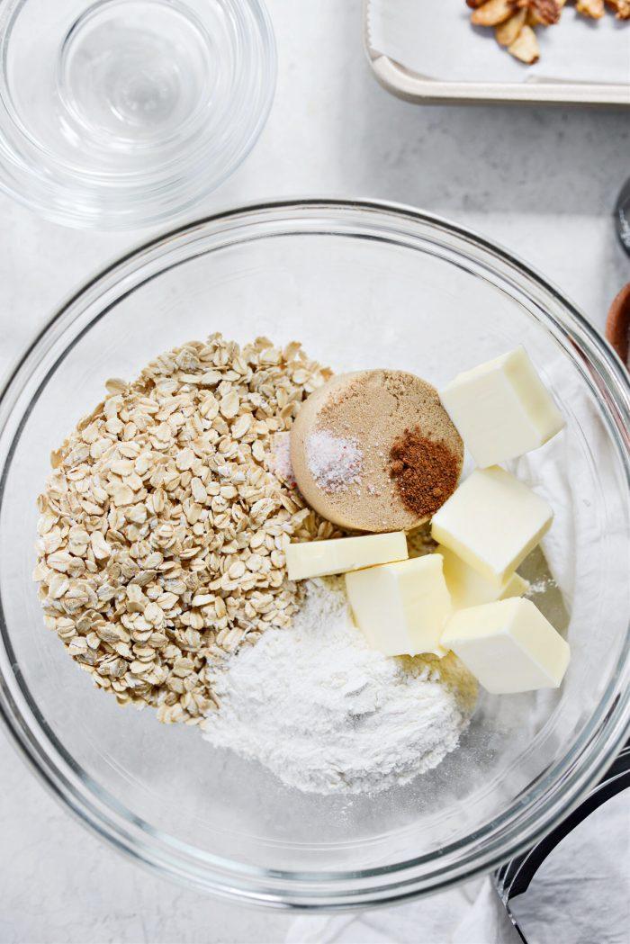 oats, flour, brown sugar, salt, nutmeg and butter in bowl