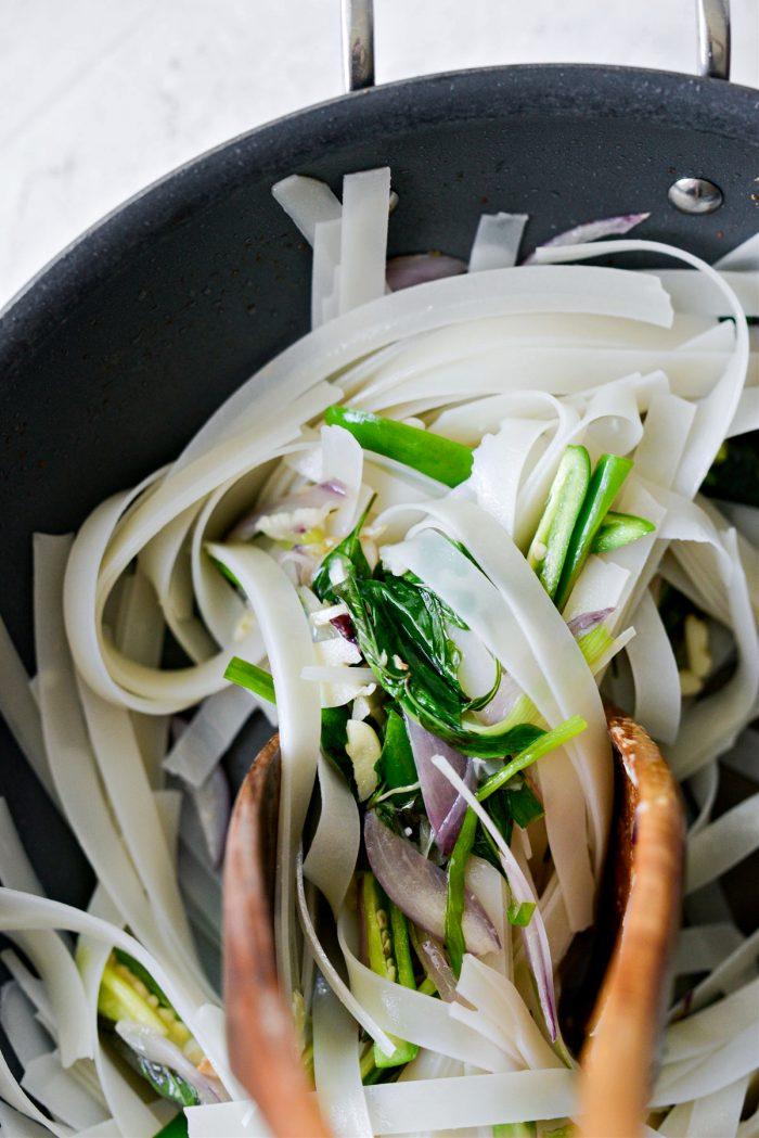 toss noodles with stir-fried veggies