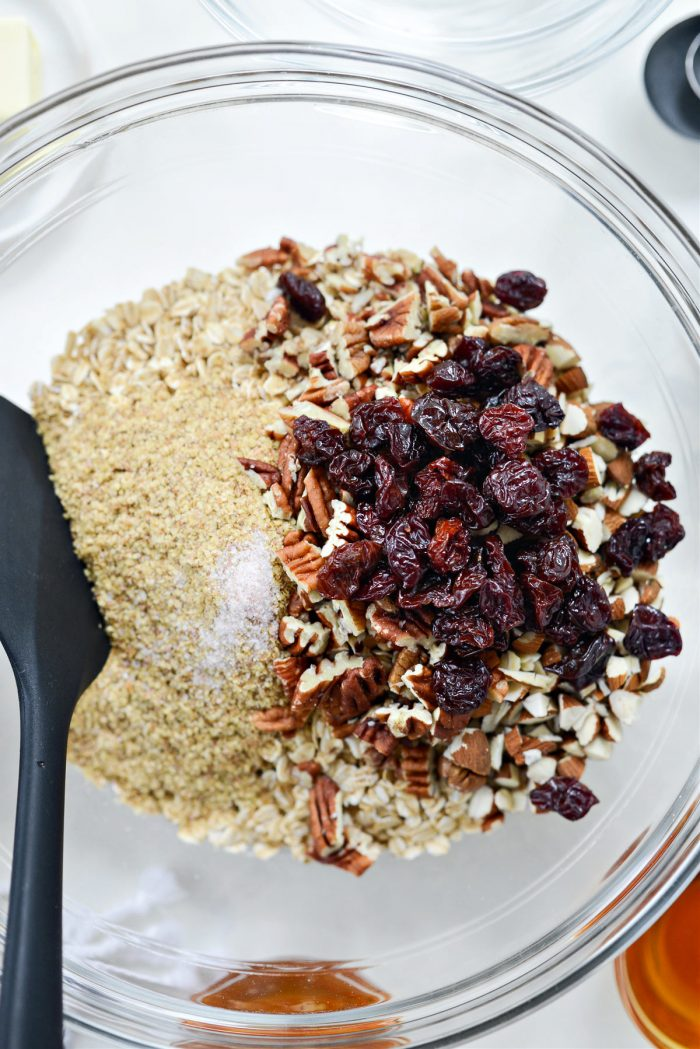 oats, wheat germ, salt, dried cherries and nuts in bowl