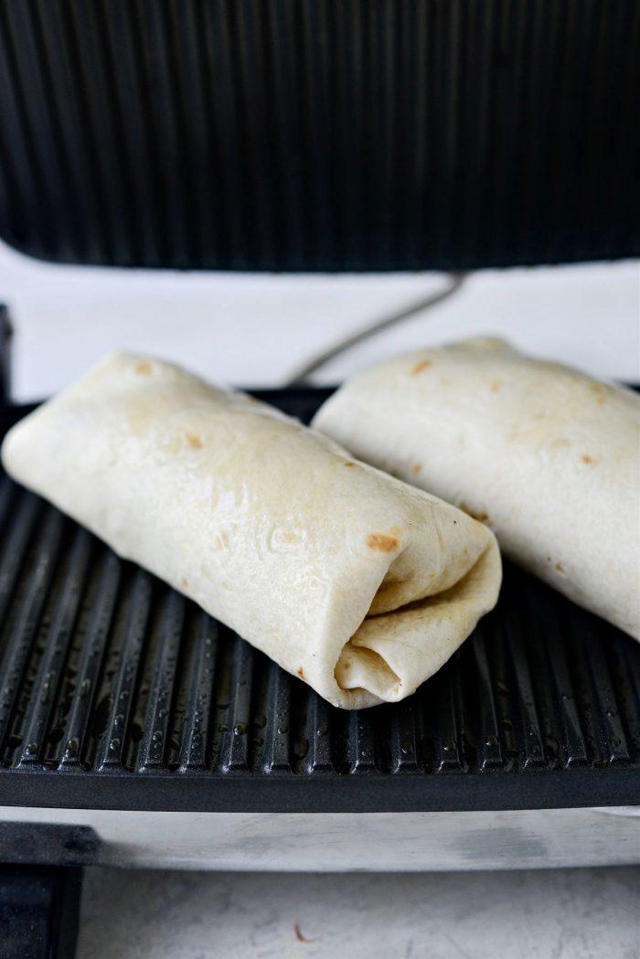 place burritos on press